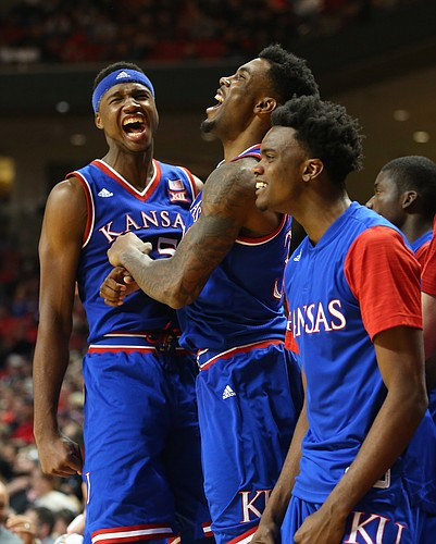 Kansas forward Carlton Bragg Jr. left, forward Jamari Traylor and guard Lagerald Vick celebrate a lob dunk to forward Perry Ellis to widen the Jayhawk's lead late in the second half, Saturday, Jan. 9, 2016 at United Spirit Arena in Lubbock, Texas.