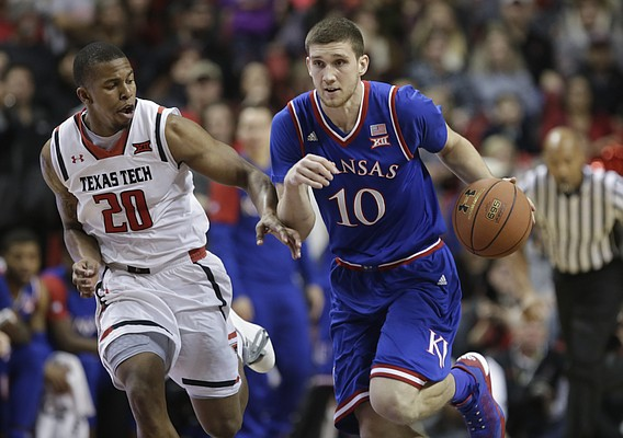 Kansas guard Sviatoslav Mykhailiuk (10) drives against Texas Tech guard Toddrick Gotcher (20) during the first half, Saturday, Jan. 9, 2016 at United Spirit Arena in Lubbock, Texas.