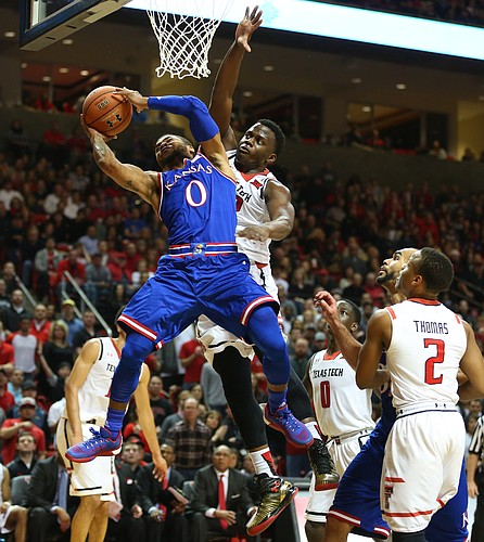 Kansas guard Frank Mason III (0) is fouled on his way up to the bucket by Texas Tech center Norense Odiase (32) during the first half, Saturday, Jan. 9, 2016 at United Spirit Arena in Lubbock, Texas.