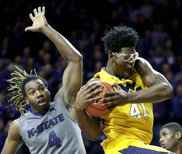 West Virginia's Devin Williams (41) beats Kansas State's D.J. Johnson to a rebound during WVU's 87-83, double-overtime victory over the Wildcats on Jan. 2 in Manhattan. The No. 17 (but likely to rise) Mountaineers will host top-ranked Kansas on Tuesday in a battle of Big 12 co-leaders.