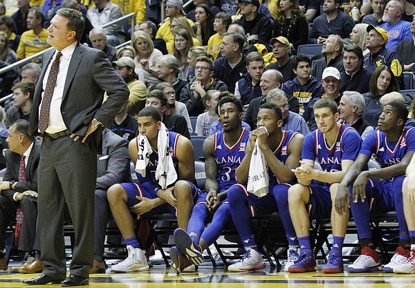 Kansas coach Bill Self and the Jayhawks bench watch the closing minutes of the Jayhawks 74-63 loss to the Mountaineers at the WVU Colliseum in Morgantown, W.V. Tuesday.