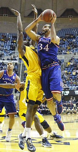Kansas forward Perry Ellis drives to the basket for two points in a game between the Jayhawks and the Mountaineers at the WVU Colliseum in Morgantown, W.V. Tuesday.