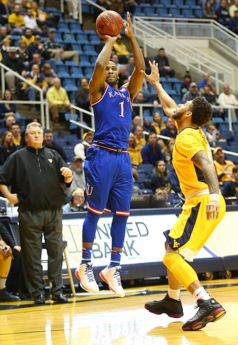 Kansas guard Wayne Selden Jr., shots in a three-point basket in the first half of a game between the Jayhawks and the Mountaineers at the WVU Colliseum in Morgantown, W.V. Tuesday.