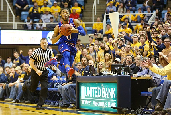 Kansas guard Frank Mason Jr., (0) jumps to make a cross court pass and break a press in a game between the Jayhawks and the Mountaineers at the WVU Colliseum in Morgantown, W.V. Tuesday.