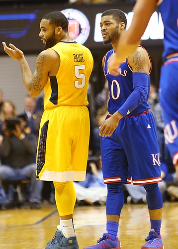 West Virginia guard Jaysean Paige (5) celebrates a West Virginia play next to Kansas guard Frank Mason III in the Jayhawks 74-63 loss to the Mountaineers in Morgantown, W.V. Tuesday.