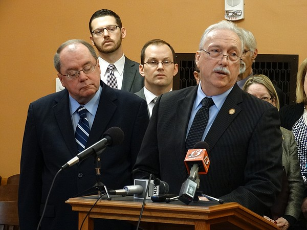 Senate Minority Leader Anthony Hensley of Topeka, left, and House Minority Leader Tom Burroughs of Kansas City join their other caucus members in announcing their priorities for the 2016 session.