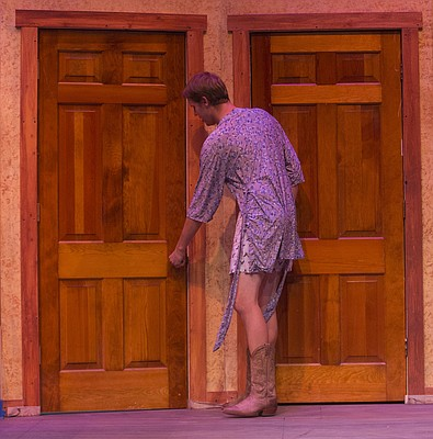 "Bubba, played by Christian Johanning, searches the house for his girlfriend during a dress rehearsal for Theatre Lawrence's upcoming production of ""Girls' Weekend"" on Thursday, Jan. 14, 2016. The show opens on Jan. 22 with a curtain time of 7:30 p.m. at Theatre Lawrence, 4660 Bauer Farm Dr."