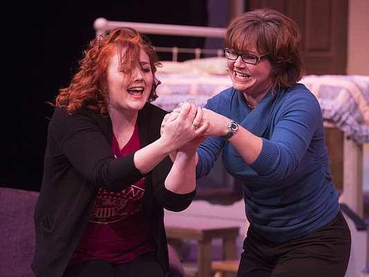 "Skye Reid, left, and Hailey Gillespie run through a scene together during a dress rehearsal for Theatre Lawrence's upcoming production of ""Girls' Weekend"" on Thursday, Jan. 14, 2016. The show opens on Jan. 22 with a curtain time of 7:30 p.m. at Theatre Lawrence, 4660 Bauer Farm Dr."