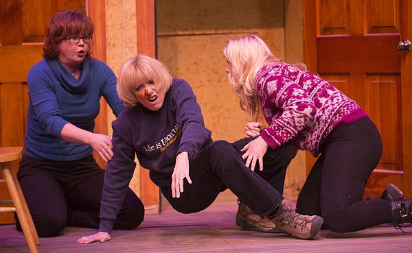 "Carol, played by Hailey Gillespie, left, and Meg, played by Wendy Long, right, help Dot, played by Jane Henry, center, to her feet during a dress rehearsal for Theatre Lawrence's upcoming production of ""Girls' Weekend"" on Thursday, Jan. 14, 2016. The show opens on Jan. 22 with a curtain time of 7:30 p.m. at Theatre Lawrence, 4660 Bauer Farm Dr."