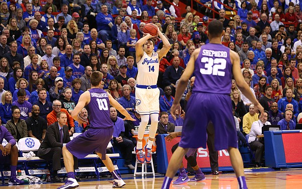 Kansas guard Brannen Greene (14) pulls up for a three in front of TCU forward Vladimir Brodziansky (10) during the first half, Saturday, Jan. 16, 2016 at Allen Fieldhouse