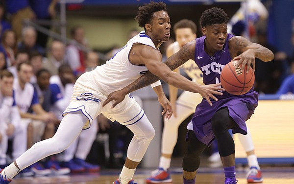 Kansas guard Devonte' Graham (4) reaches for an attempted steal from TCU guard Chauncey Collins (1) during the first half, Saturday, Jan. 16, 2016 at Allen Fieldhouse.