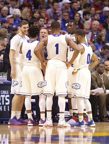Kansas head coach Bill Self huddles up the Jayhawks during the first half, Saturday, Jan. 16, 2016 at Allen Fieldhouse