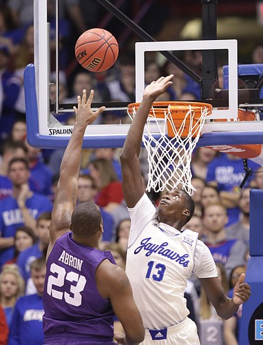 Kansas forward Cheick Diallo (13) gets up to reject a shot from TCU forward Devonta Abron (23) during the first half, Saturday, Jan. 16, 2016 at Allen Fieldhouse