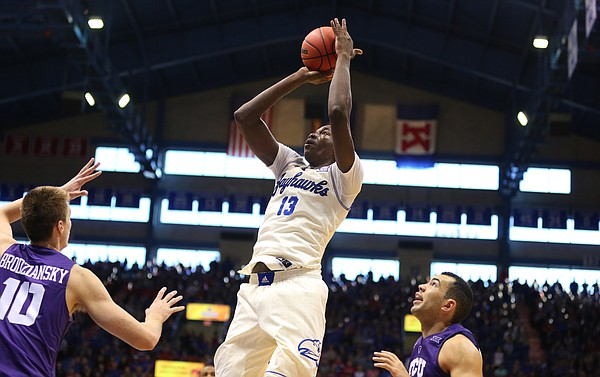 Kansas forward Cheick Diallo (13) pulls up for a jumper over TCU forward Vladimir Brodziansky (10) and guard Michael Williams (2) during the second half, Saturday, Jan. 16, 2016 at Allen Fieldhouse.