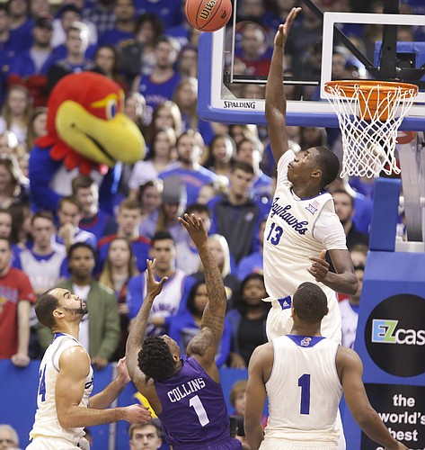Kansas forward Cheick Diallo (13) gets up to reject a shot from TCU guard Chauncey Collins (1) during the second half, Saturday, Jan. 16, 2016 at Allen Fieldhouse. Also pictured are Kansas forward Perry Ellis (34) and guard Wayne Selden Jr. (1).