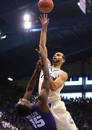 Kansas forward Perry Ellis lofts a shot over TCU forward JD Miller (15) during the second half, Saturday, Jan. 16, 2016 at Allen Fieldhouse.