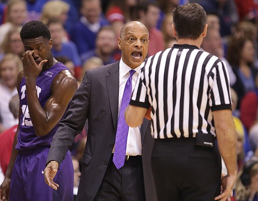 TCU head coach Trent Johnson argues a with an official over a foul called against the Horned Frogs during the first half, Saturday, Jan. 16, 2016 at Allen Fieldhouse
