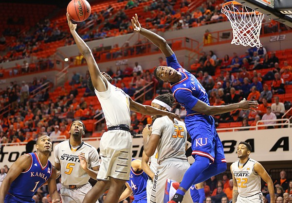 Kansas forward Cheick Diallo (13) loses a rebound to Oklahoma State guard Jawun Evans (1) during the first half, Tuesday, Jan. 19, 2016 at Gallagher-Iba Arena in Stillwater, Okla.