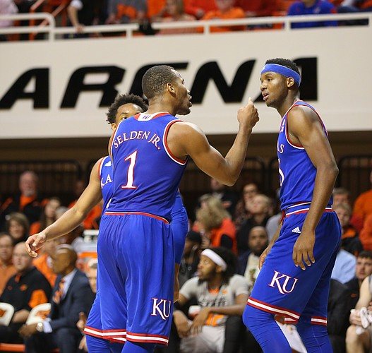 Kansas guard Wayne Selden Jr. (1) has words for forward Carlton Bragg Jr. (15) after Bragg threw a pass to an Oklahoma State defender during the first half, Tuesday, Jan. 19, 2016 at Gallagher-Iba Arena in Stillwater, Okla.