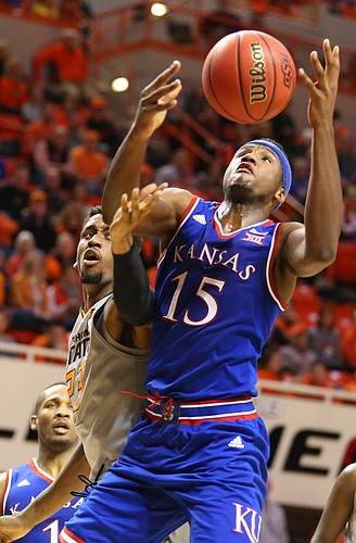 Kansas forward Carlton Bragg Jr. (15) fights for a rebound with Oklahoma State guard Leyton Hammonds (23) during the second half, Tuesday, Jan. 19, 2016 at Gallagher-Iba Arena in Stillwater, Okla.