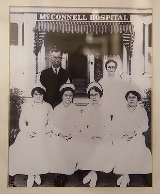 A handful of small, private hospitals served Lawrence in the early 20th century, as this vintage image of nurses and a doctor at McConnell Hospital, near Eighth and New Hampshire streets, shows. The photograph is one of many pieces in an exhibit detailing Lawrence's medical history at the Watkins Museum of History, 1047 Massachusetts St.