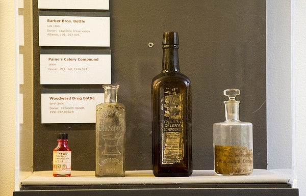 """A series of medical bottles on display at the Watkins Museum of History's """"Remedies and Memories exhibit, from left: Rankin Drug store, 1955; a Barber Bros. bottle, late 1800s; Paine's Celery Compound, 1890; and a bottle from Woodward Drug Bottle, early 1900s. The exhibit, which chronicles the history of medicine in Lawrence, opens Friday at the Watkins, 1047 Massachusetts St."""