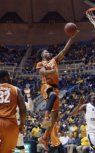 Texas guard Isaiah Taylor (1) drives to the basket during the first half of an NCAA college basketball game against West Virginia, Wednesday, Jan, 20, 2016, in Morgantown, W.Va. Texas defeated West Virginia 56-49. (AP Photo/Raymond Thompson)