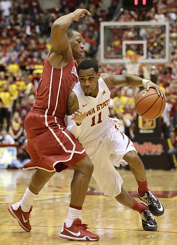Iowa State guard Monte Morris drives around Oklahoma guard Dinjiyl Walker, left, during the second half of an NCAA college basketball game, Monday, Jan. 18, 2016, in Ames, Iowa. Iowa State won 82-77. (AP Photo/Charlie Neibergall)