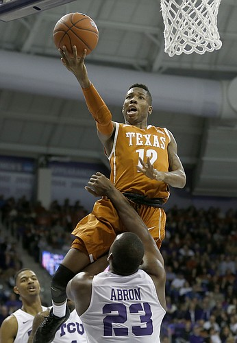 Texas guard Kerwin Roach Jr. (12) drives inside and shoots over TCU forward Devonta Abron (23) during the first half of an NCAA college basketball game, Saturday, Jan. 9, 2016, in Fort Worth, Texas. (AP Photo/Ron Jenkins)