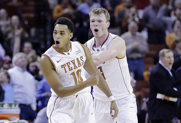 Texas guard Eric Davis Jr. (10) and teammate Connor Lammert (21) celebrate after Davis hit a three-point shot against the Texas Arlington during overtime of an NCAA college basketball game, Tuesday, Dec. 1, 2015, in Austin, Texas. Texas won 80-75. (AP Photo/Eric Gay)