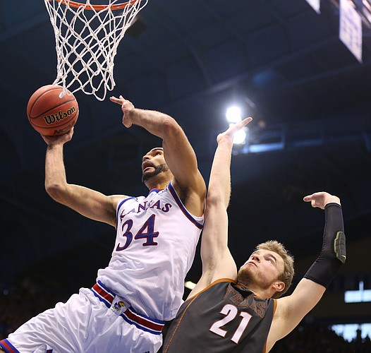 Kansas forward Perry Ellis (34) bangs inside for a shot and a foul from Texas forward Connor Lammert (21) during the second half, Saturday, Jan. 23, 2016 at Allen Fieldhouse.