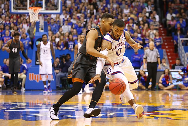 Kansas guard Frank Mason III (0) collides with Texas guard Eric Davis Jr. (10) going for a loose ball during the second half, Saturday, Jan. 23, 2016 at Allen Fieldhouse.