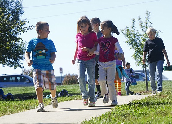 From left, Bennett Stammeyer, 6, Nevaeh Hogan, 6, and Natalie Caroll, 6, were part of the 300-student-strong marathon club at Langston Hughes Elementary School in Lawrence, shown in this file photo from October 2013.