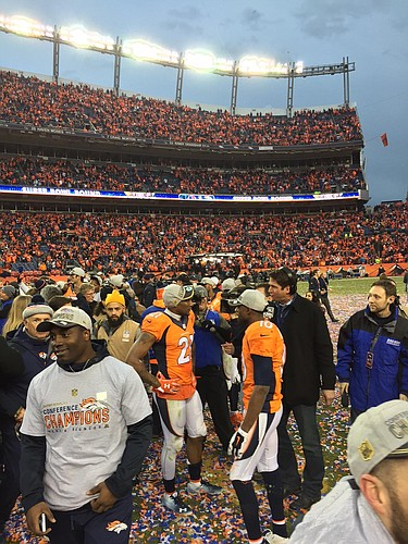 Former KU cornerback Aqib Talib preps for an interview on the field following Denver's AFC title game victory on Sunday. (Photo courtesy David Beaty)