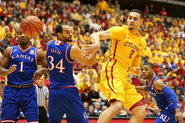 Iowa State forward Abdel Nader (2) throws a backdoor pass around Kansas forward Perry Ellis (34) and guard Wayne Selden Jr. (1) during the first half, Monday, Jan. 25, 2016 at Hilton Coliseum in Ames, Iowa. Also pictured is Kansas guard Frank Mason III (0).