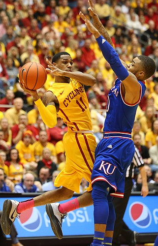 Iowa State guard Monte Morris (11) looks to pass around Kansas guard Frank Mason III (0) during the first half, Monday, Jan. 25, 2016 at Hilton Coliseum in Ames, Iowa.