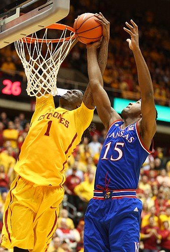 Kansas forward Carlton Bragg Jr. (15) disrupts a dunk attempt by Iowa State forward Jameel McKay (1) during the first half, Monday, Jan. 25, 2016 at Hilton Coliseum in Ames, Iowa.
