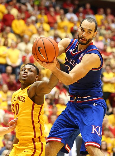 Kansas forward Perry Ellis (34) catches a pass inside before Iowa State guard Deonte Burton (30) during the second half, Monday, Jan. 25, 2016 at Hilton Coliseum in Ames, Iowa.