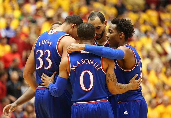 The Kansas players huddle together to try to rally from behind during the second half, Monday, Jan. 25, 2016 at Hilton Coliseum in Ames, Iowa.