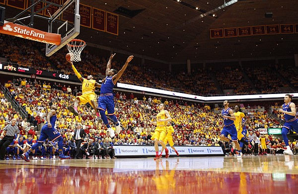 Iowa State guard Monte Morris (11) gets to the bucket against Kansas guard Wayne Selden Jr. (1) during the first  half, Monday, Jan. 25, 2016 at Hilton Coliseum in Ames, Iowa.