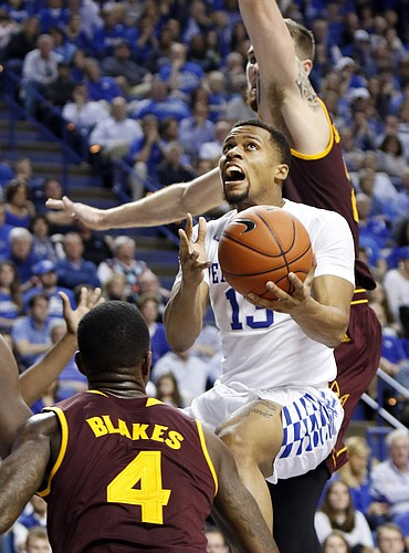 Kentucky's Isaiah Briscoe, middle, shoots between Arizona State's Gerry Blakes (4) and Eric Jacobsen during the second half of an NCAA college basketball game Saturday, Dec. 12, 2015, in Lexington, Ky. Kentucky won 72-58. (AP Photo/James Crisp)
