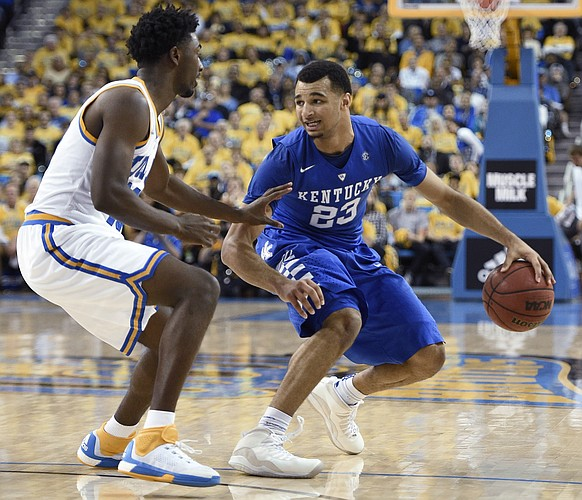 Kentucky guard Jamal Murray, right, moves the ball as UCLA guard Isaac Hamilton defends during the second half of an NCAA college basketball game in Los Angeles, Thursday, Dec. 3, 2015. UCLA won 87-77. (AP Photo/Kelvin Kuo)