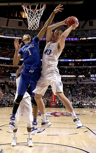 Duke center Marshall Plumlee snags a rebound over Kentucky forward Skal Labissiere (1) during the first half of an NCAA basketball game, Tuesday, Nov. 17, 2015, in Chicago. (AP Photo/Nam Y. Huh)