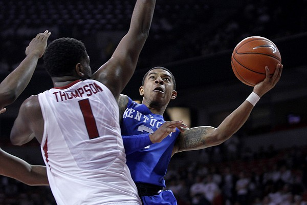Kentucky's Tyler Ulis, right, shoots around Arkansas' Trey Thompson (1) during the second half of an NCAA college basketball game Thursday, Jan. 21, 2016, in Fayetteville, Ark. Kentucky won 80-66. (AP Photo/Samantha Baker)