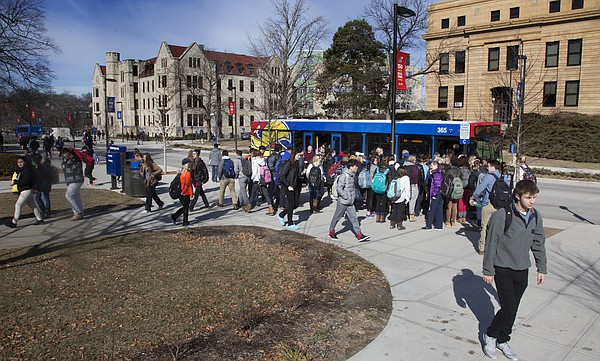 Students move along Jayhawk Boulevard on the KU campus between classes on Wednesday January 27, 2016.