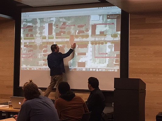 Josh Shelton, a principal with architecture firm el dorado inc., presents an updated plan for the East Ninth Project during Wednesday's East Ninth Citizen Advisory Committee meeting. The plan would narrow East Ninth Street and incorporate sharrows, native grasses and ADA-accessible sidewalks.