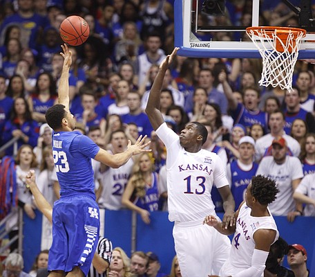 Kansas forward Cheick Diallo (13) defends a shot by Kentucky guard Jamal Murray (23) during the first half, Saturday, Jan. 30, 2016 at Allen Fieldhouse.