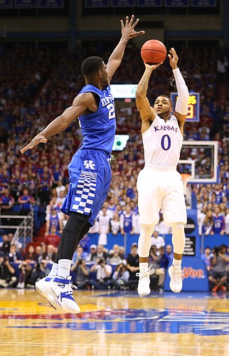 Kansas guard Frank Mason III (0) puts a three over Kentucky forward Alex Poythress (22) during the second half, Saturday, Jan. 30, 2016 at Allen Fieldhouse.