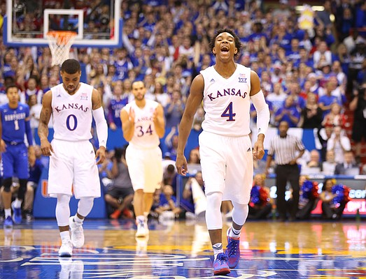 Kansas guard Devonte' Graham (4) flashes a wide smile as the Jayhawks begin to close the gap during the second half, Saturday, Jan. 30, 2016 at Allen Fieldhouse.