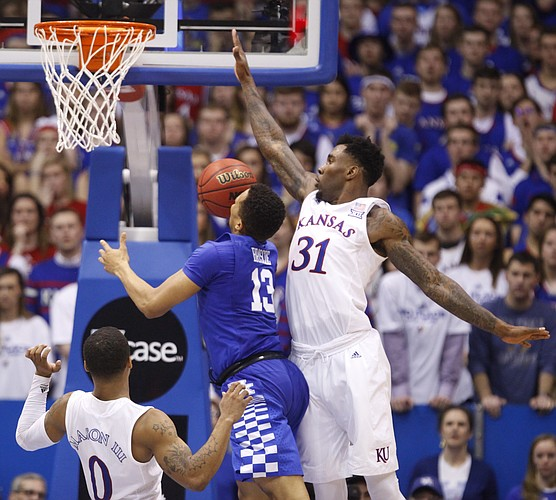 Kansas forward Jamari Traylor (31) defends against a shot by Kentucky guard Isaiah Briscoe (13) during the second half, Saturday, Jan. 30, 2016 at Allen Fieldhouse.